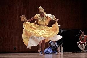 XV Festival del Tambor y las Culturas Africanas en Mèxico Grupo Cubano danza orisha bailarina vestido amarillo